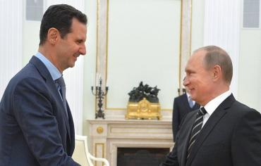 بوتين يهنئ الأسد