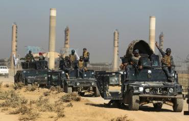 تقدم سريع للقوات العراقية بمواجهة البشمركة ونزوح كردي من كركوك