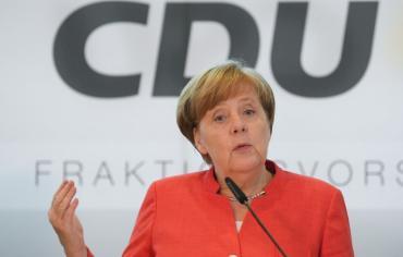 ميركل واثقة بايجاد حلول مع فرنسا لاصلاح منطقة اليورو