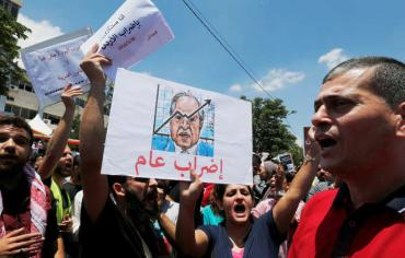 """أنباء عن رحيل وشيك لحكومة الملقي في الأردن على خلفية """"أزمة الضريبة"""""""